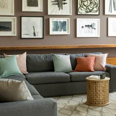 A living room in neutral paint colours sets a relaxing, warm tone.
