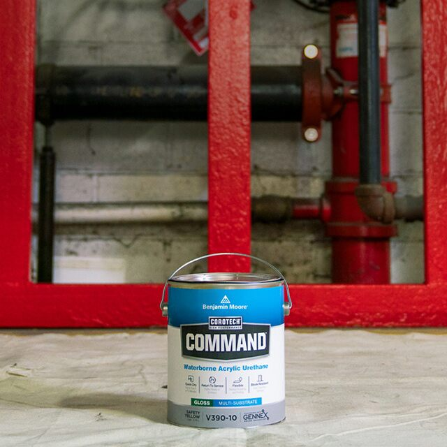 A gallon of Corotech® COMMAND® on a paint canvas in a warehouse.