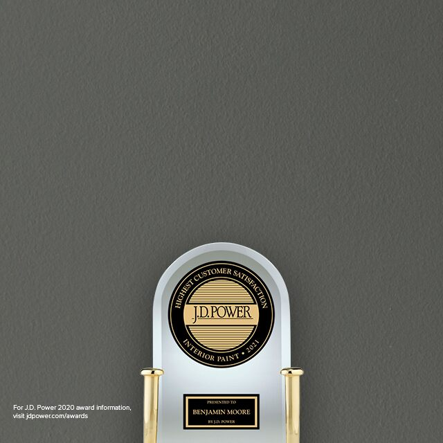 The iconic J.D. Power Award trophy honoring the highest customer satisfaction for interior paint placed in front of a dark gray wall.