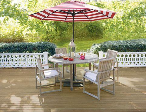Relaxing outdoor deck space with table and umbrella