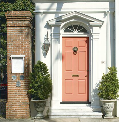 The orange paint used on this city home's front door features Gennex® Colour Technology.