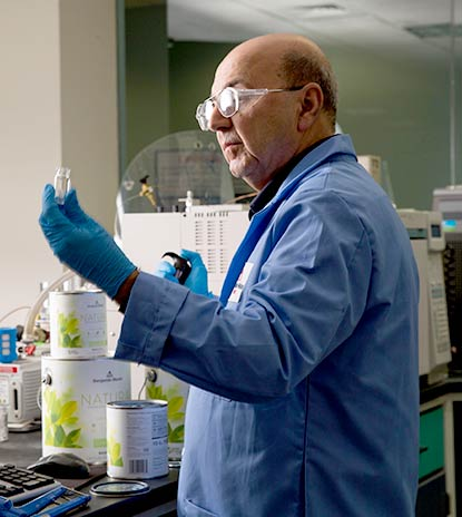 A senior scientist in Benjamin Moore's R&D lab measures samples of Natura Interior paint.