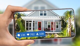 Phone taking a picture of a home exterior for social media.
