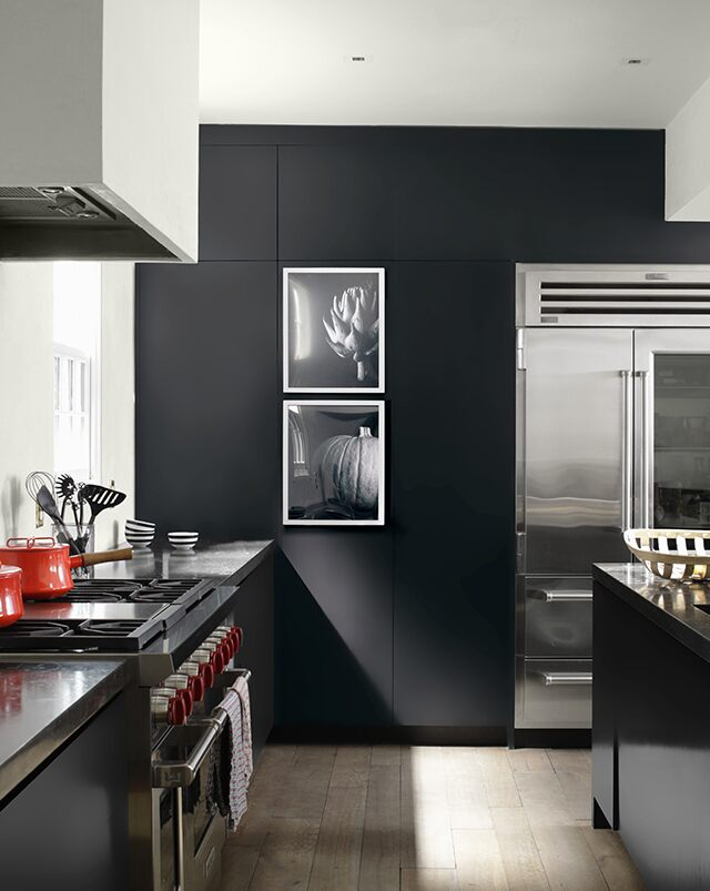 A slick, black kitchen accent wall painted in Black Tar 2126-10