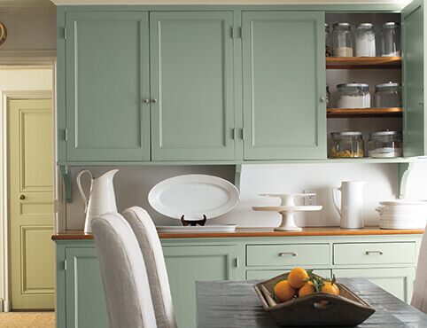 Pale green kitchen cabinets