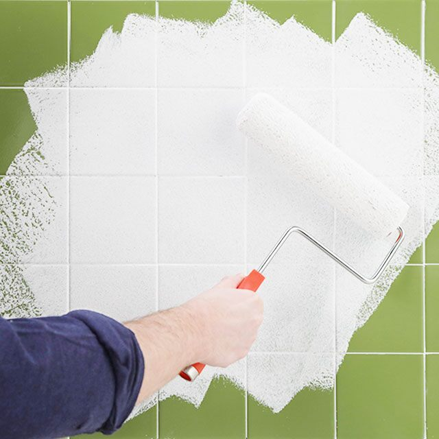 Tile surface being primed with a paint roller