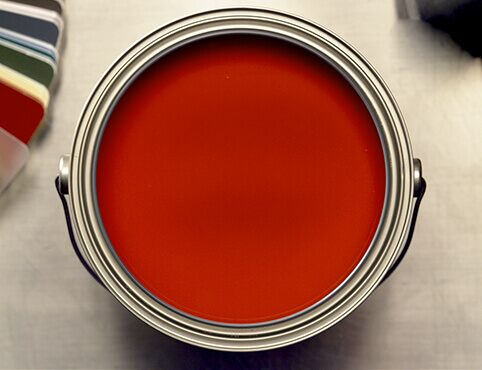 An open can of red paint