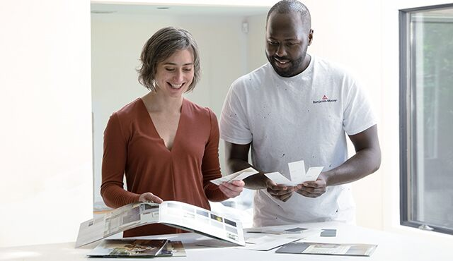 A customer and contractor review paint samples