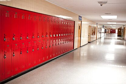 A bank of red, impact-resistant lockers offer both longevity and aesthetic appeal when sealed with high durability enamel coating.