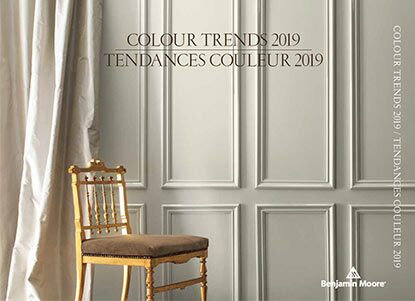 A gray-painted wall and cream-coloured silk curtains frame a formal gold chair. Colour of the Year 2019