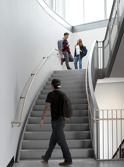 A bright white college stairwell drives home  the aesthetic allure of a  clean, scuff-free space.